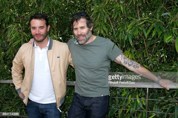 Actors Yaniss Lespert and his brother Jalil Lespert attend the 2017 French Tennis Open Day Thirteen at Roland Garros on June 9 2017 in Paris France