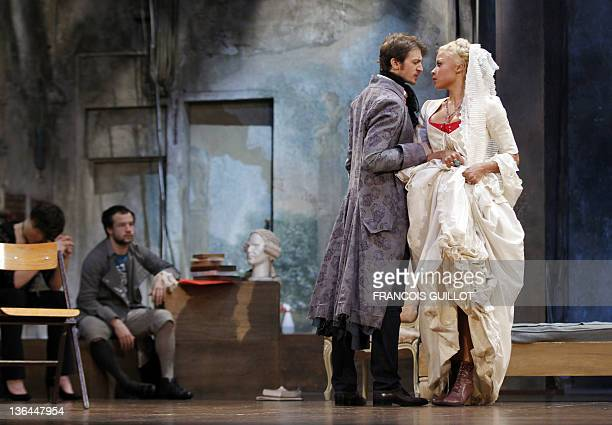 Actors Yannick Landrein performing as Vicomte de Vermont and Jina Djemba rehearse during the photocall of US John Malkovich's theatre play 'Les...
