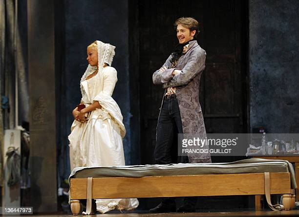 Actors Yannick Landrein performing as Vicomte de Vermont and Jina Djemba are pictured during the photo call of US John Malkovich's theatre play 'Les...