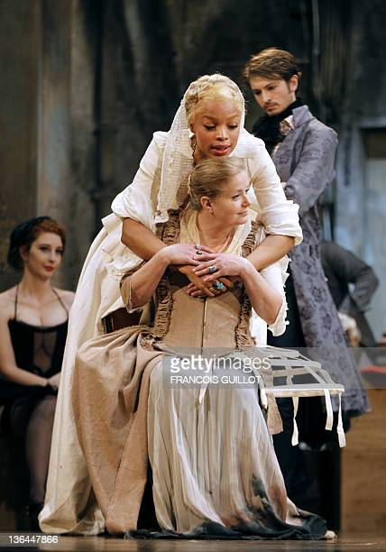 Actors Yannick Landrein performing as Vicomte de Vermont Jina Djemba and Sophie Barjac are pictured during the photo call of US John Malkovich's...