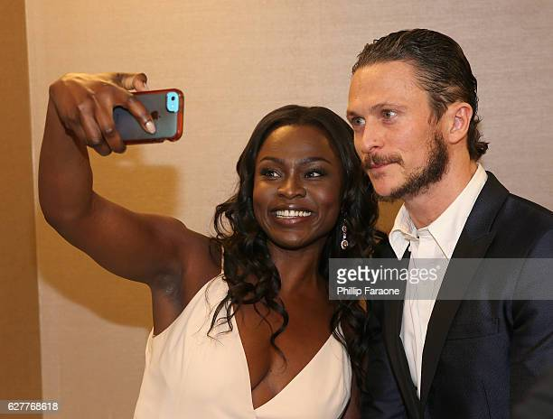Actors Yetide Badaki and Jonathan Tucker attend The Trevor Project's 2016 TrevorLIVE LA at The Beverly Hilton Hotel on December 4 2016 in Beverly...