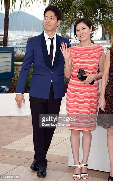 Actors Yu Junsang and Moon Sori attend the 'Dareun Naraesuh' Photocall during the 65th Annual Cannes Film Festival at Palais des Festivals on May 21...
