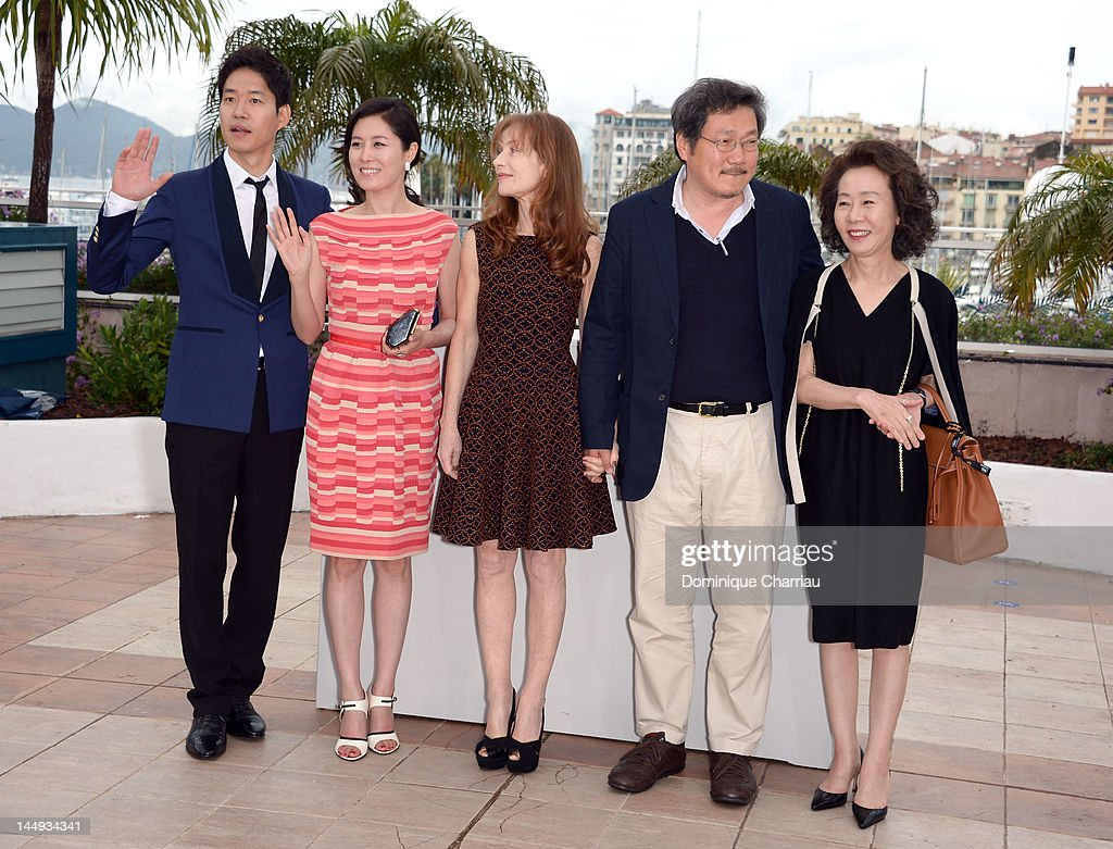 Actors Yu Junsang, Moon Sori, <a gi-track='captionPersonalityLinkClicked' href=/galleries/search?phrase=Isabelle+Huppert&family=editorial&specificpeople=662796 ng-click='$event.stopPropagation()'>Isabelle Huppert</a>, director Hong Sangsoo and actress Youn Yuh-jung attend the 'Da-reun Na-ra-e-suh' Photocall during the 65th Annual Cannes Film Festival at Palais des Festivals on May 21, 2012 in Cannes, France.