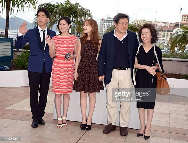 Actors Yu Junsang Moon Sori Isabelle Huppert director Hong Sangsoo and actress Youn Yuhjung attend the 'Dareun Naraesuh' Photocall during the 65th...