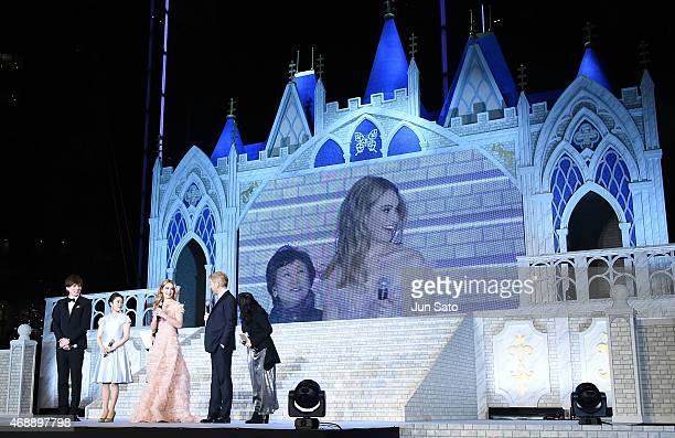 Actors Yu Shorota Mitsuki Takahata Lily James and director Kenneth Branagh attend the premiere of 'Cinderella' on April 8 2015 at Roppongi Hills in...