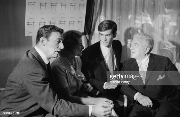 Actors Yves Montand Ingrid Bergman Anthony Perkins with Russianborn American filmmaker Anatole Litvak on the set of romantic drama film 'Goodbye...