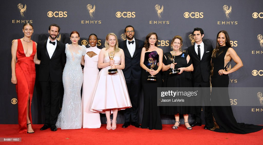 Actors Yvonne Strahovski, Joseph Fiennes, Madeline Brewer, Samira Wiley, Elisabeth Moss, O-T Fagbenle, Alexis Bledel, Ann Dowd, Max Minghella and Amanda Brugel of 'The Handmaid's Tale', winners of Outstanding Drama Series, pose in the press room the 69th annual Primetime Emmy Awards at Microsoft Theater on September 17, 2017 in Los Angeles, California.