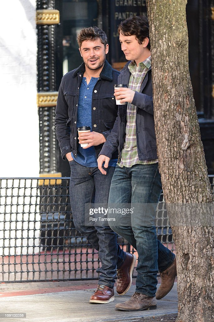 Actors Zac Efron (L) and Miles Teller film a scene at the 'Are We Officially Dating?' movie set in Grammercy Park on January 7, 2013 in New York City.