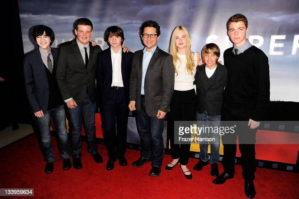 Actors Zach Mills Riley Griffiths Joel Courtney director JJ Abrams and actors Elle Fanning Ryan Lee and Gabriel Basso arrive at Paramount Pictures'...