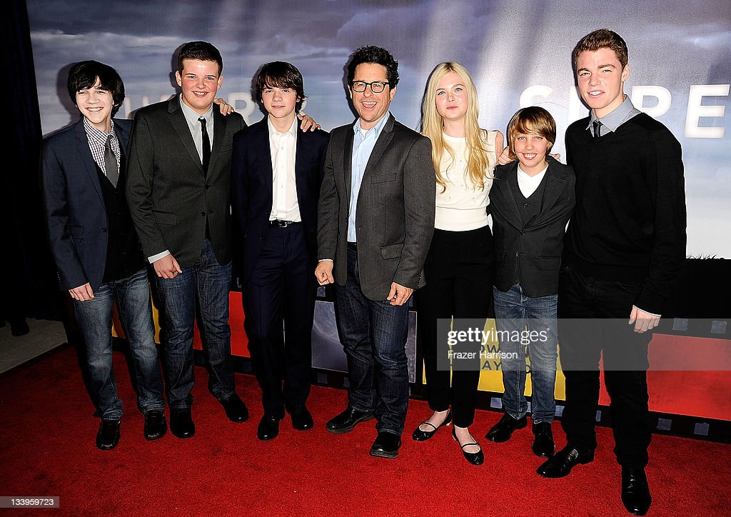 Actors Zach Mills, Riley Griffiths, Joel Courtney, director J.J. Abrams and actors Elle Fanning, Ryan Lee and Gabriel Basso arrives at Paramount Pictures' 'Super 8' Blu-ray and DVD release party at AMPAS Samuel Goldwyn Theater on November 22, 2011 in Beverly Hills, California.