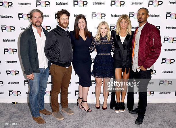 Actors Zachary Knighton Adam Pally Casey Wilson Elisha Cuthbert Eliza Coupe and Damon Wayans Jr pose backstage during Entertainment Weekly's PopFest...