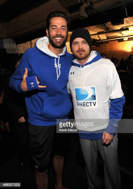 Actors Zachary Levi and Aaron Paul attend the DirecTV Beach Bowl at Pier 40 on February 1 2014 in New York City