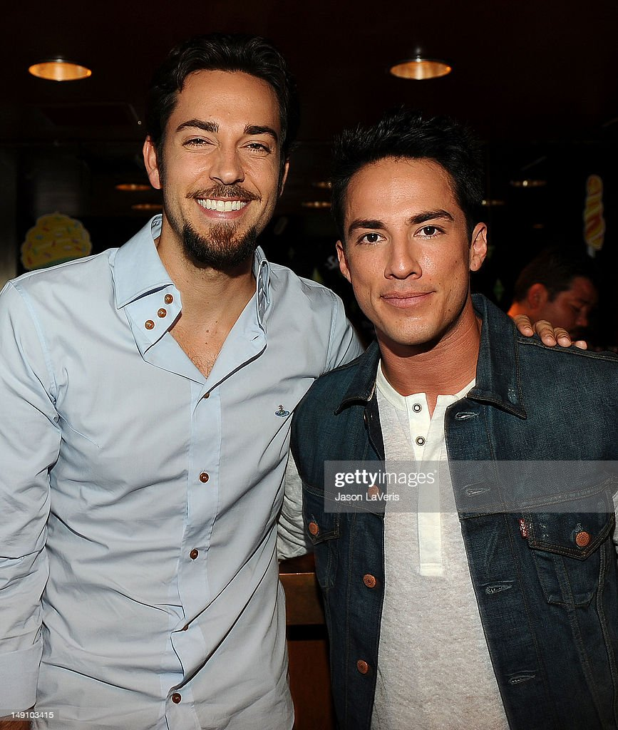Actors Zachary Levi and Michael Trevino pose in the green room at the 2012 Teen Choice Awards at Gibson Amphitheatre on July 22, 2012 in Universal City, California.
