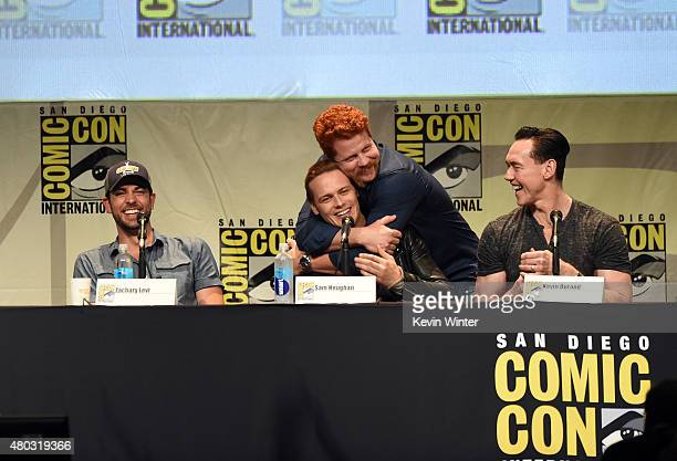 Actors Zachary Levi Sam Heughan Michael Cudlitz and Kevin Durand speak onstage at the Entertainment Weekly Brave New Warriors panel during ComicCon...