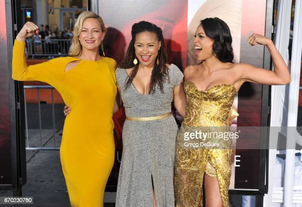 Actors Zoe Bell Tracie Thoms and Rosario Dawson arrive at the premiere of Warner Bros Pictures' 'Unforgettable' at TCL Chinese Theatre on April 18...