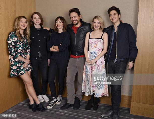 Actors Zoe Levin Jack Kilmer director Gia Coppola actors James Franco Emma Roberts and Nat Wolff pose for the 'Palo Alto' cast portrait during the...