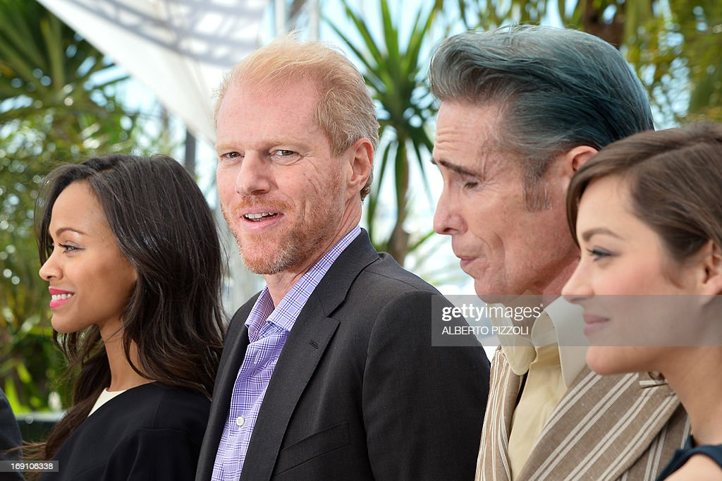 US actors Zoe Saldana and Noah Emmerich, tattoo artist and actor Mark Mahoney and French actress Marion Cotillard pose on May 20, 2013 during a photocall for the film 'Blood Ties' presented Out of Competition at the 66th edition of the Cannes Film Festival in Cannes. Cannes, one of the world's top film festivals, opened on May 15 and will climax on May 26 with awards selected by a jury headed this year by Hollywood legend Steven Spielberg. AFP PHOTO / ALBERTO PIZZOLI
