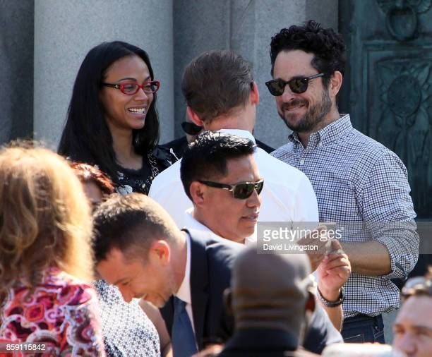 Actors Zoe Saldana and Simon Pegg and director JJ Abrams attend the Anton Yelchin life celebration and statue unveiling ceremony at Hollywood Forever...