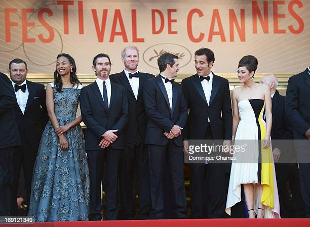 Actors Zoe Saldana Billy Crudup Noah Emmerich director Guillaume Canet actor Clive Owen and actress Marion Cotillard attend the Premiere of 'Blood...