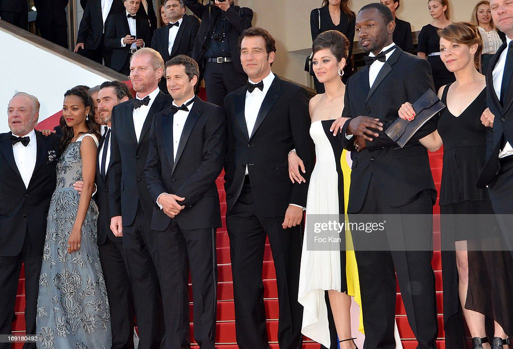 Actors Zoe Saldana, Billy Crudup, Noah Emmerich, director Guillaume Canet, actor Clive Owen, actress Marion Cotillard and Jamie Hector attend the Premiere of 'Blood Ties' during the 66th Annual Cannes Film Festival at the Palais des Festivals on May 20, 2013 in Cannes, France.