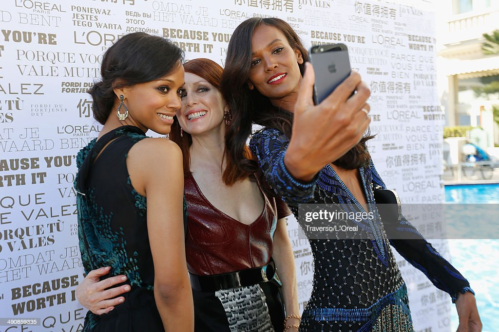 Actors <a gi-track='captionPersonalityLinkClicked' href=/galleries/search?phrase=Zoe+Saldana&family=editorial&specificpeople=542691 ng-click='$event.stopPropagation()'>Zoe Saldana</a>, <a gi-track='captionPersonalityLinkClicked' href=/galleries/search?phrase=Julianne+Moore&family=editorial&specificpeople=171555 ng-click='$event.stopPropagation()'>Julianne Moore</a> and <a gi-track='captionPersonalityLinkClicked' href=/galleries/search?phrase=Liya+Kebede&family=editorial&specificpeople=220361 ng-click='$event.stopPropagation()'>Liya Kebede</a> take a selfie at the 'Mr Turner' premiere during the 67th Annual Cannes Film Festival on May 15, 2014 in Cannes, France.