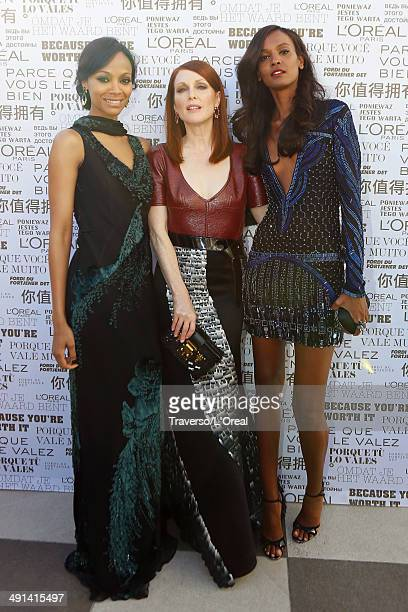 Actors Zoe Saldana Julianne Moore and model Liya Kebede attend the 'Mr Turner' premiere during the 67th Annual Cannes Film Festival on May 15 2014 in...