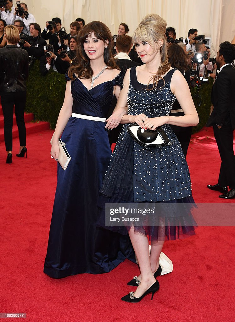 Actors Zooey Deschanel (L) and Tennessee Thomas attend the 'Charles James: Beyond Fashion' Costume Institute Gala at the Metropolitan Museum of Art on May 5, 2014 in New York City.