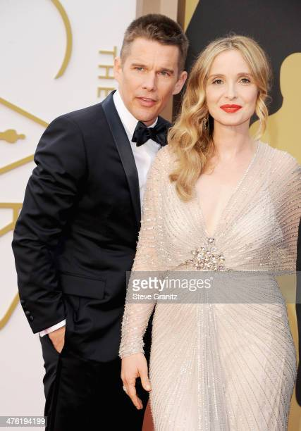 Actor/screenwriter Ethan Hawke and actress/screenwriter Julie Delpy attend the Oscars held at Hollywood Highland Center on March 2 2014 in Hollywood...