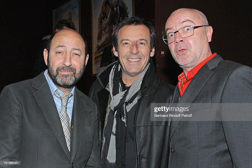 Actors/directors Kad Merad (L) and Olivier Baroux (R), and television show host Jean-Luc Reichmann attend the Paris Premiere of the movie 'Mais Qui A Re Tue Pamela Rose' at Cinema Gaumont Marignan on December 2, 2012 in Paris, France.