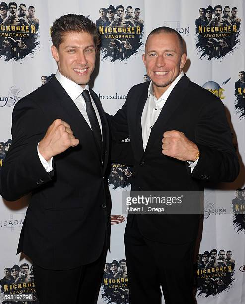 Actors/fighters Alain Moussi and Georges StPierre arrive for the Premiere Of RLJ Entertainment's 'Kickboxer Vengeance' held at iPic Theaters on...