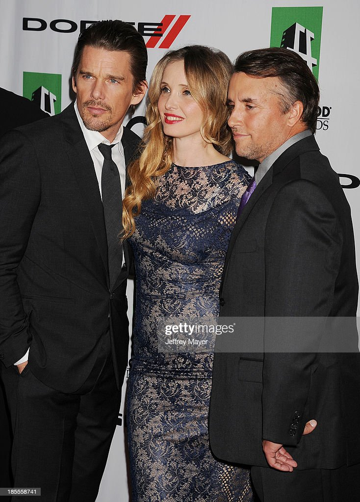 Actors/honorees Ethan Hawke, Julie Delpy and director Richard Linklater arrive at the 17th Annual Hollywood Film Awards at The Beverly Hilton Hotel on October 21, 2013 in Beverly Hills, California.