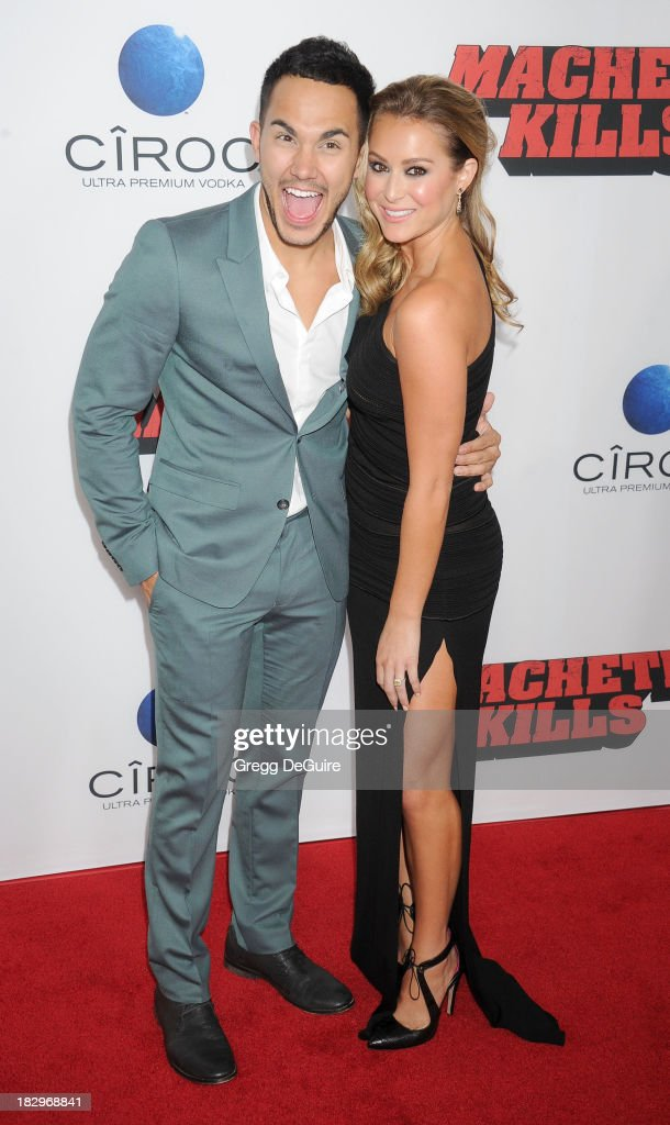 Actor/singer Carlos Pena Jr. and actress Alexa Vega arrive at the Los Angeles premiere of 'Machete Kills' at Regal Cinemas L.A. Live on October 2, 2013 in Los Angeles, California.