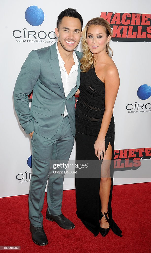 Actor/singer Carlos Pena Jr. and actress Alexa Vega arrive at the Los Angeles premiere of 'Machete Kills' at Regal Cinemas L.A. Live on October 2, 2013 in Los Angeles, California.