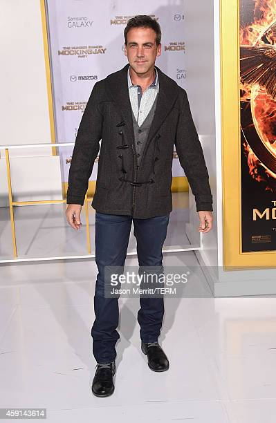 Actor/singer Carlos Ponce attends the Premiere of Lionsgate's 'The Hunger Games Mockingjay Part 1' at Nokia Theatre LA Live on November 17 2014 in...