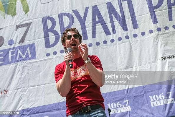 Actor/singer Christian Borle from the broadway musical 'Something Rotten' performs live on stage during 1067 LITE FM's Broadway in Bryant Park held...