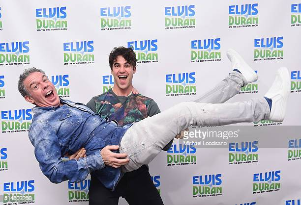 Actor/singer Darren Criss picks up Elvis Duran during Criss's visit to 'The Elvis Duran Z100 Morning Show' at Z100 Studio on March 11 2016 in New...