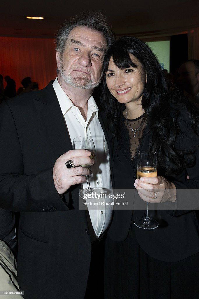 Actor/singer <a gi-track='captionPersonalityLinkClicked' href=/galleries/search?phrase=Eddy+Mitchell&family=editorial&specificpeople=2050587 ng-click='$event.stopPropagation()'>Eddy Mitchell</a> (L) poses with screenwriter/photographer Valerie Perrin, the companion of director Claude Lelouch, during a paerty following the premiere of 'Salaud, on t'aime' (Bastard, we love you) directed by French director Claude Lelouch at Cinema UGC Normandie on March 31, 2014 in Paris, France.