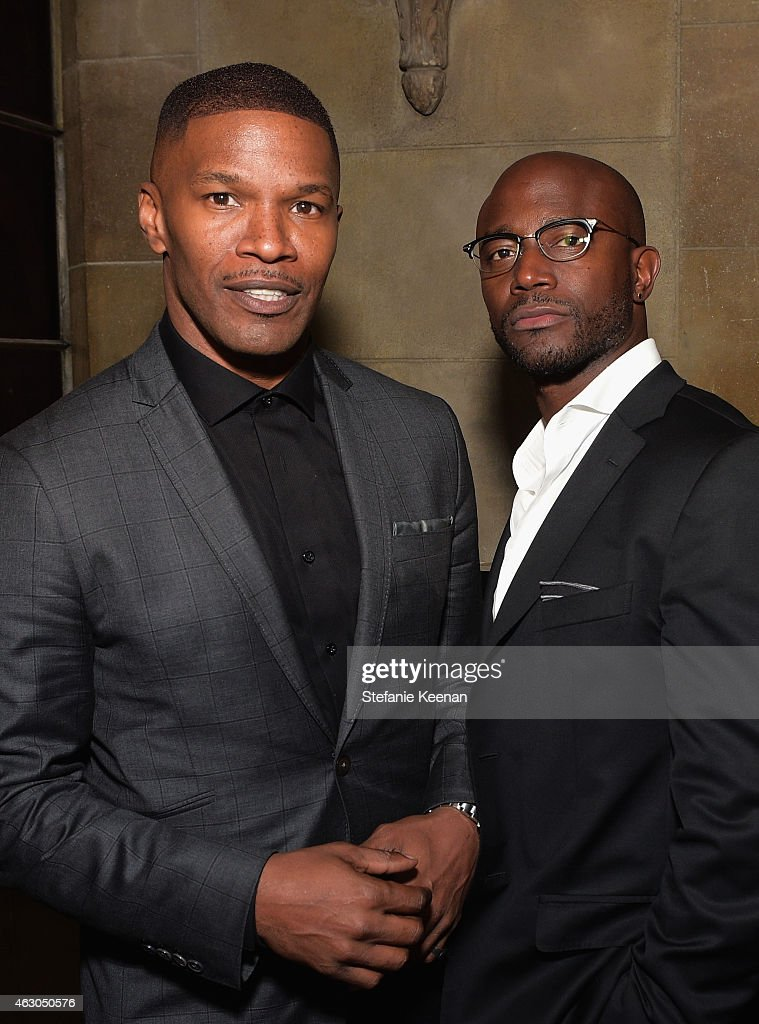 Actor/singer Jamie Foxx (L) and actor Taye Diggs attend the Warner Music Group annual Grammy celebration at Chateau Marmont on February 8, 2015 in Los Angeles, California.