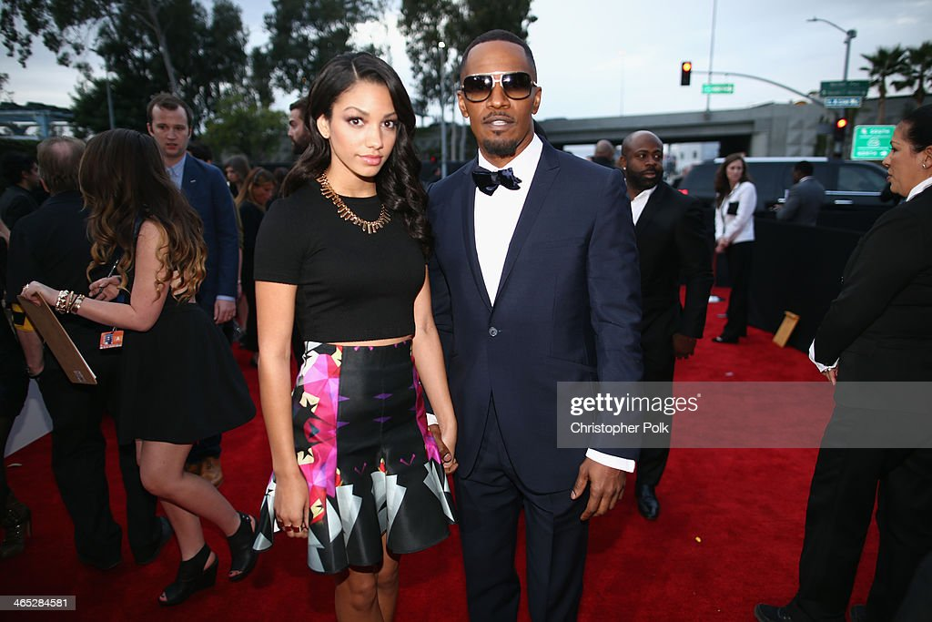 Actor-singer <a gi-track='captionPersonalityLinkClicked' href=/galleries/search?phrase=Jamie+Foxx&family=editorial&specificpeople=201715 ng-click='$event.stopPropagation()'>Jamie Foxx</a> (R) and Corinne Bishop attend the 56th GRAMMY Awards at Staples Center on January 26, 2014 in Los Angeles, California.