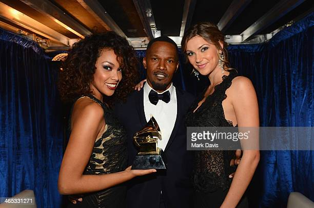 Actor/singer Jamie Foxx and trophy girls attend the 56th GRAMMY Awards at Staples Center on January 26 2014 in Los Angeles California
