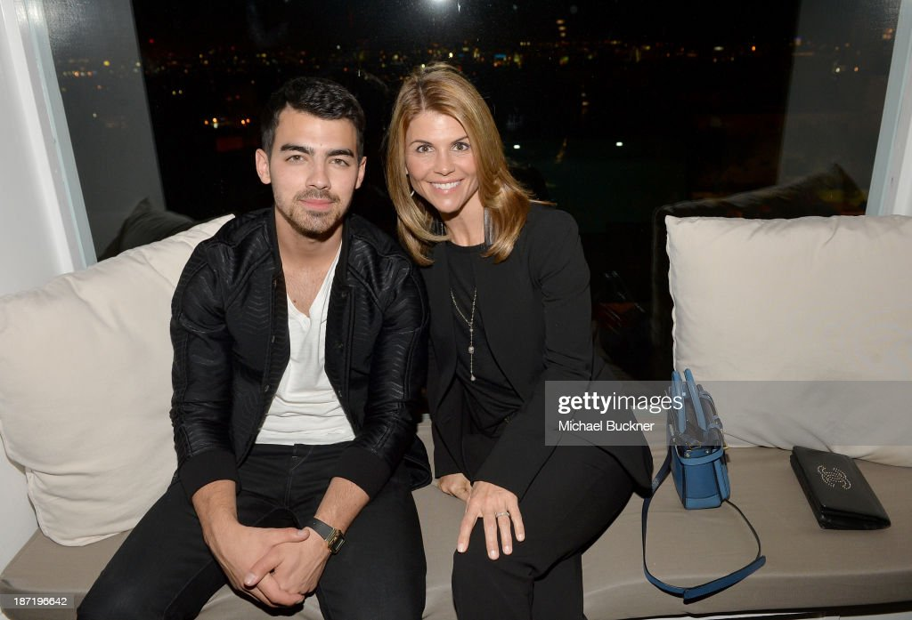 Actor/singer <a gi-track='captionPersonalityLinkClicked' href=/galleries/search?phrase=Joe+Jonas&family=editorial&specificpeople=842712 ng-click='$event.stopPropagation()'>Joe Jonas</a> (L) and actress <a gi-track='captionPersonalityLinkClicked' href=/galleries/search?phrase=Lori+Loughlin&family=editorial&specificpeople=208147 ng-click='$event.stopPropagation()'>Lori Loughlin</a> attend Cotton Incorporated's Blue Jeans Go Green celebrates 1 million pieces of denim collected for recycling at SkyBar at the Mondrian Los Angeles on November 6, 2013 in West Hollywood, California.