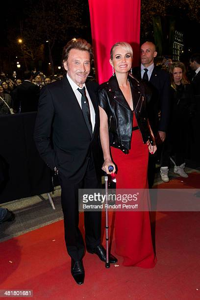 Actor/singer Johnny Hallyday arrives with his wife Laeticia to the premiere of 'Salaud on t'aime' directed by French director Claude Lelouch at...