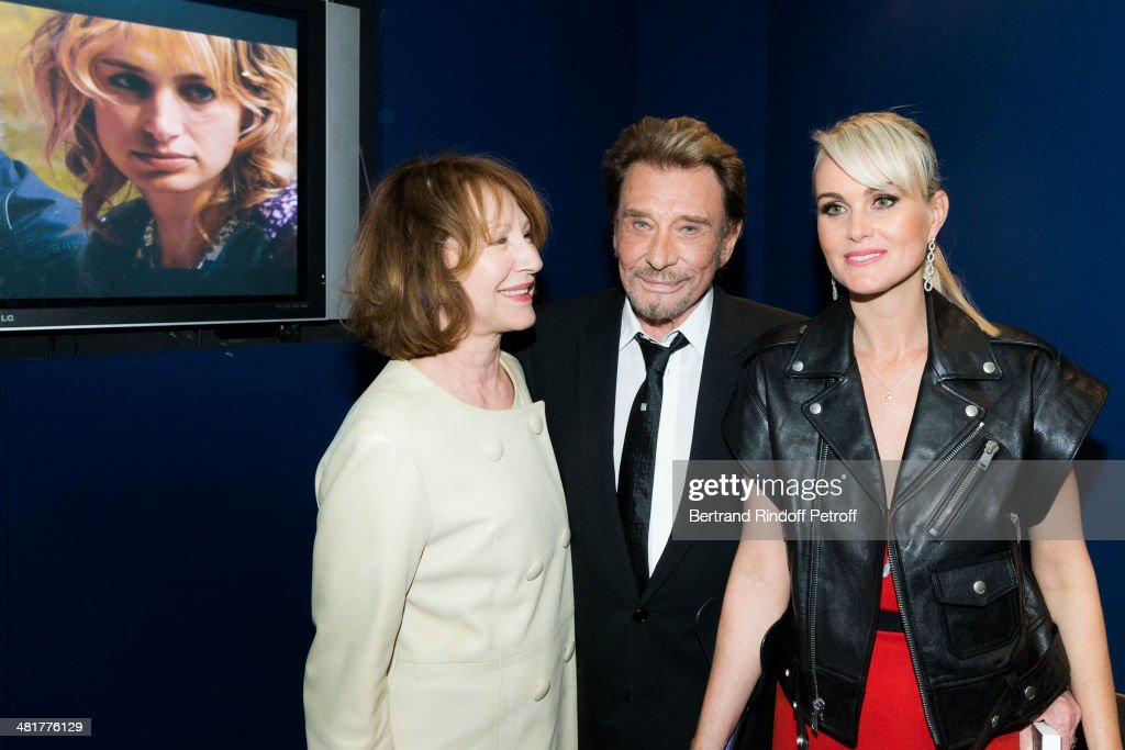 Actor/singer Johnny Hallyday (C) poses with his wife Laeticia (R) and his former partner, actress Nathalie Baye, during the premiere of French director Claude Lelouch's film 'Salaud, on t'aime' (Bastard, we love you) at Cinema UGC Normandie on March 31, 2014 in Paris, France.