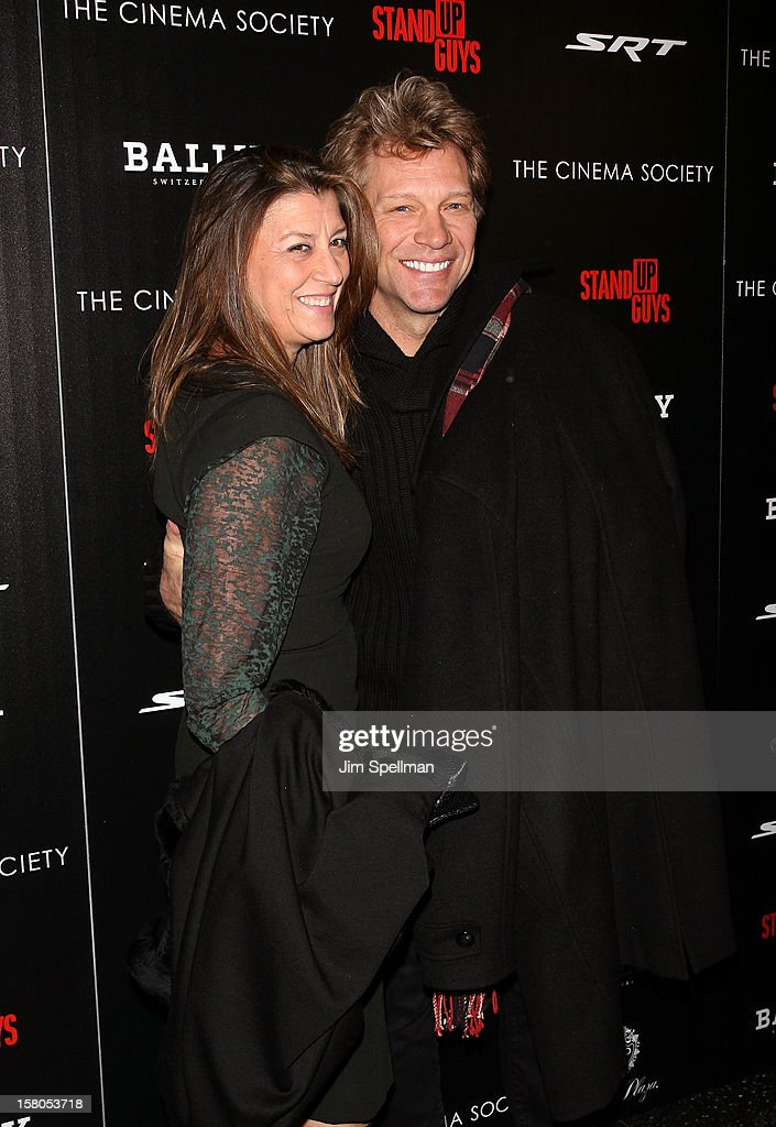 Actor/singer <a gi-track='captionPersonalityLinkClicked' href=/galleries/search?phrase=Jon+Bon+Jovi&family=editorial&specificpeople=201527 ng-click='$event.stopPropagation()'>Jon Bon Jovi</a> (R) and wife Dorothea Hurley attend The Cinema Society With Chrysler & Bally premiere of 'Stand Up Guys' at Museum of Modern Art on December 9, 2012 in New York City.
