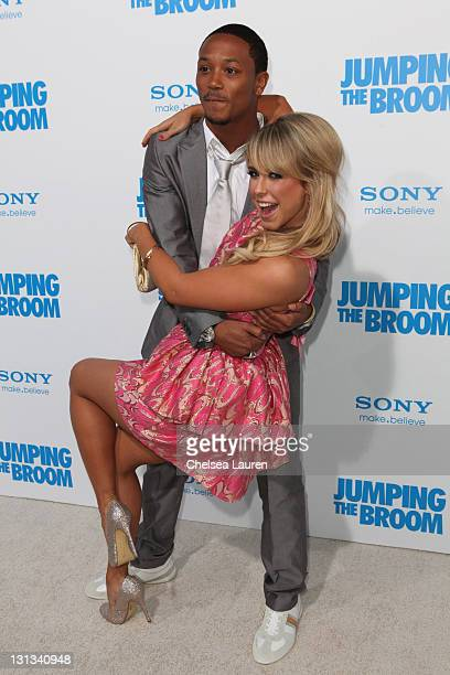 Actor/singer Romeo Miller and dancer Chelsie Hightower arrive at the Los Angeles premiere of 'Jumping The Broom' at ArcLight Cinemas Cinerama Dome on...