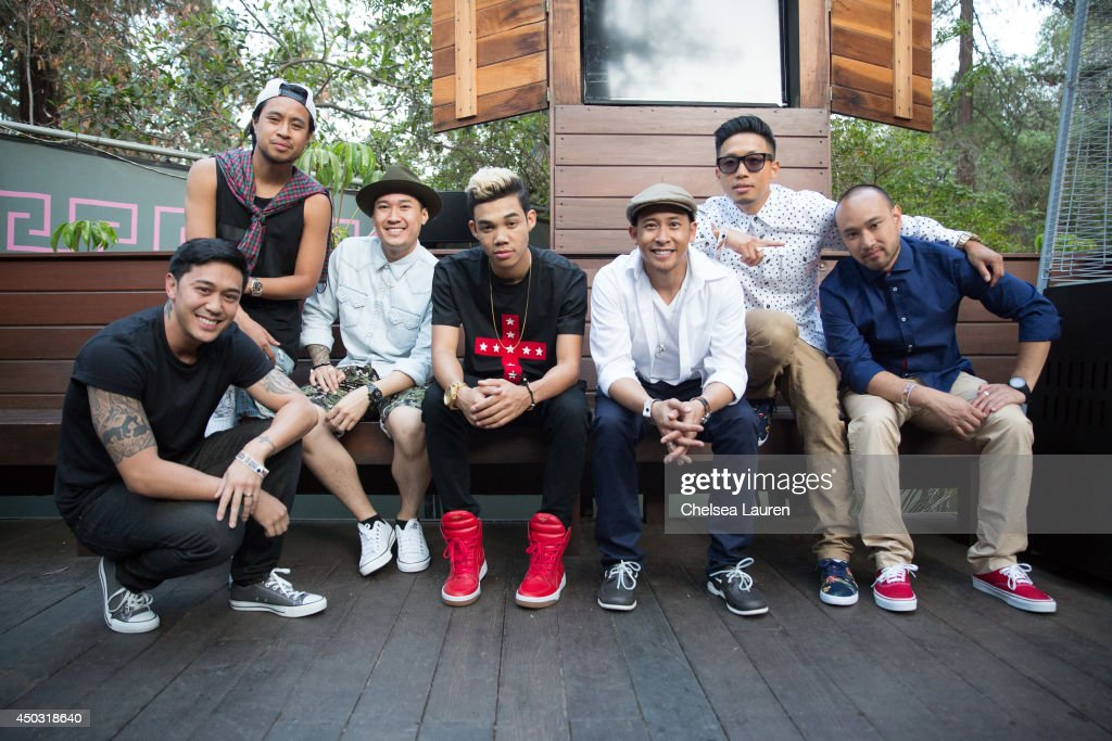 Actor/singer Roshon Fegan poses with The Jabbawockeez backstage at the 'Rebuild' benefit concert for Typhoon Haiyan survivors at The Greek Theatre on...