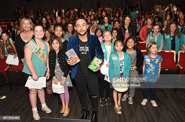 Actor/Singer Tahj Mowry and girl scouts pose at The Girl Scouts Education Event at The GRAMMY Museum on March 22 2015 in Los Angeles California