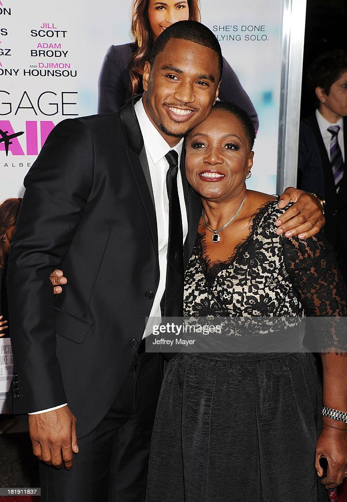 Actor/singer <a gi-track='captionPersonalityLinkClicked' href=/galleries/search?phrase=Trey+Songz&family=editorial&specificpeople=674835 ng-click='$event.stopPropagation()'>Trey Songz</a> (L) and grandmother arrive at the Los Angeles premiere of 'Baggage Claim' at Regal Cinemas L.A. Live on September 25, 2013 in Los Angeles, California.