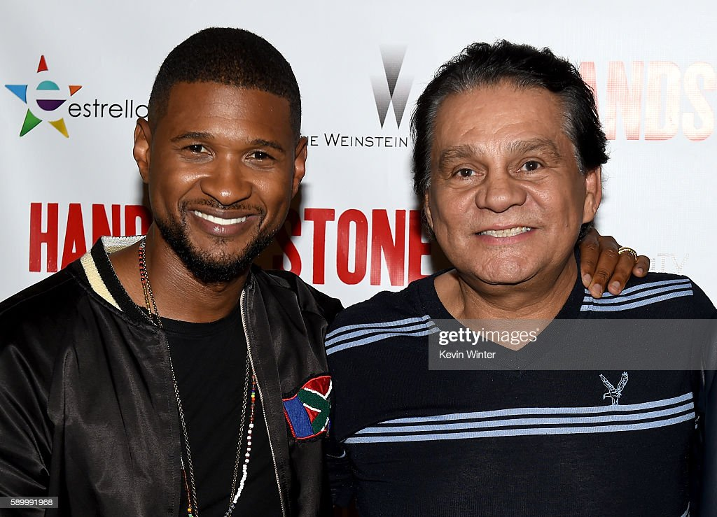 Actor/singer Usher Raymond and former professional boxer Roberto Duran arrive at a screening of the Weinstein Company's 'Hands of Stone' at the...