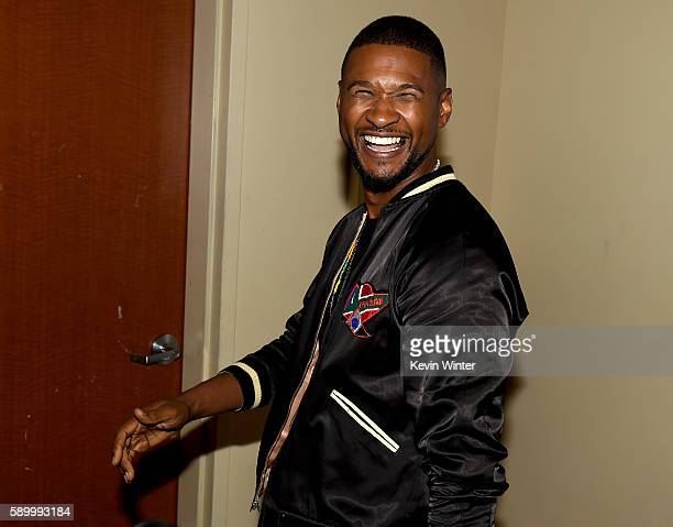Actor/singer Usher Raymond arrives at a screening of the Weinstein Company's 'Hands of Stone' at the Pacific Theatres at The Grove on August 15 2015...